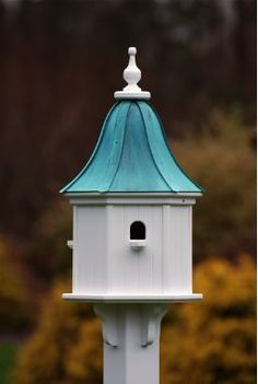 Copper Roof Birdhouse is stunning with architectural detail. Constructed of PVC/Vinyl to last a lifetime, with no worries of rotting, cracking, splitting or fading... it's guaranteed! Features 3 compa