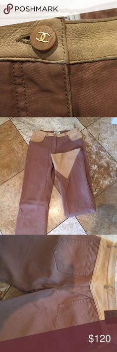 Chanel tan denim jeans w/ leather trim. Size 40 Chanel tan denim with light tan leather trim Vintage but great condition. Size 40. Waist 15 flat.  Inseam 34. Rise 10 in.   Super cute wooden button with gold CC CHANEL Jeans Straight Leg