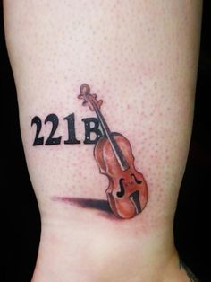 The iconic house number and the violin, by Miss Fortune.