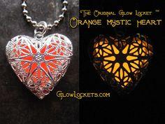 The Original Glow Lockets ™ handmade in New Orleans, Louisiana GlowLockets.com    Here is the Heart Shaped Mystic Glow Locket ™ with Orange Tangerine