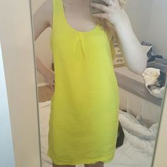 Old Navy Bright Yellow Dress Old Navy bright yellow dress. Super fun to accessorize! Dress is light and airy. No rips or fading. Body of dress is 78% rayon and 22% nylon. Lining is is 100% polyester with a small mark of what looks like sharpie. You can see in the last picture it is barely visible and in the first picture that I have it on, you can barely see it at all. True to size. **Bundle 3 or more items and get 10% off** Old Navy Dresses Midi