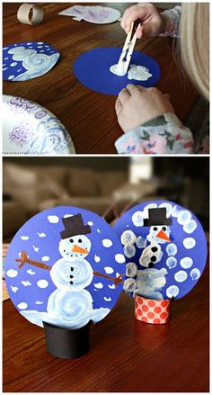 Pom-pom painted snow globe winter craft for kids to make! W e used a toilet paper roll for the base! | CraftyMorning.com