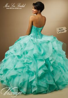 Style LYZAF EMBROIDERY AND BEADING ON LACE WITH RUFFLED ORGANZA SKIRT. Matching Bolero Jacket. Available in Aqua, Champagne, White. Precio: $ 5.351.775 Pesos Colombianos / Precio: $ 1.621,75 Dólares Americanos