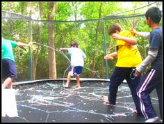 """Silly String fun inside a trampoline enclosure - This was a hit at my son's birthday party. Best of all, EASY CLEAN UP because all the boys had to do was just scoop up the stringy mess which was fun because they made a giant ball - hence, made another game of catch the """"silly string ball!"""""""