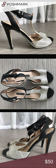 """French Connection """"Nella"""" Sandal French connection snake embossed vamp with skinny black stripes on a t-strap sandal. Stacked, slender 4"""" heel. Adjustable buckle closure. Leather upper, synthetic and leather lining. Fits true to size. French Connection Shoes Heels"""