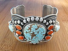 American Indian Darrel Cadman Sterling Silver Lone Mountain Turquoise and Mediterranean Coral Cuff Bracelet 1 3/4 inches wide back opening 1 1/4 inches 132 Grams.