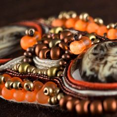 Close up of orange and brown infused pendant from the Soutache range! Available to buy at Create and Craft - http://www.createandcraft.tv/SearchGridView.aspx?fh_location=//CreateAndCraft/en_GB/$s=soutache&gs=soutache
