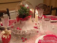 Valentine cloche with miniature roses on pedestal cake plate.