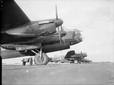 Avro Lancasters of No. 514 Squadron RAF, lined up at Waterbeach, Cambridgeshire, before taking part in a daylight attack on fortified villages east of Caen, in support of the Second Army's armoured offensive in the Normandy battle area (Operation GOODWOOD)..