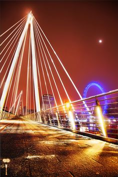 One of the Golden Jubilee Bridges, crossing the Thames from Southbank to Enbankment.   I can't tell how many times I walked across that bridge, but it would've been in the hundreds. Such a fantastic view of the city and the river...and so romantic at night. :)