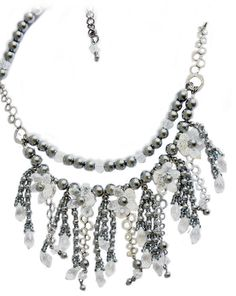 Not for the faint hearted, the Silver Dollar necklace combines silver and crystal for some serious bling!