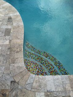 Step into pool season in style with your very own unique custom glass tile accent. Don't stop there! Our beautiful tiles can be used as waterline or water feature accents, or you can even tile your entire pool with our glass tiles for a one-of-a-kind finish that is super easy to clean! #tile #backyard #pool #home #homedesign #homedecor #renovation #outdoor #swimmingpool