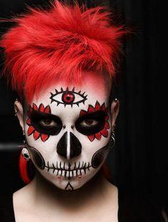 maquillage d`Halloween avec des cheveux rouges et un troisième oeil sur le front