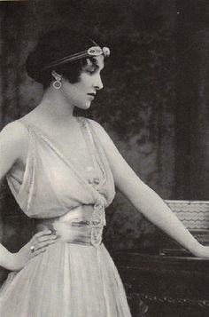 Poise, 1916, Edwardian....Perfect contrast, the shimmering of her waistband and the softness to her skin....