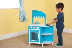 Plum Hendon Wooden Role Play Kitchen: This bright and colourful wooden kitchen is perfect for little chefs and includes an oven with door that opens and closes, printed hobs and knobs on the oven that click and turn, taps and a removable sink and a shelf to hang utensils from.