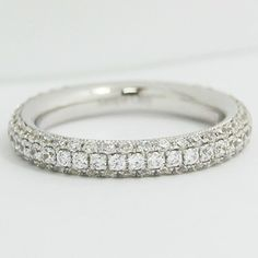 This pricey ornate 2.7mm rounded micro pave diamond #wedding band is bedecked with a hundred and eighteen beautiful small diamond to create that flattering continuous sparkling surface as light hits the many different facets of the band.