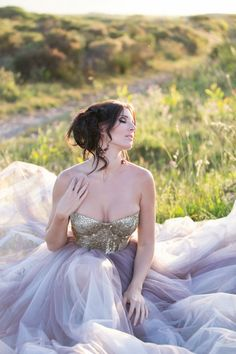 Gold sequin bustier and royal purple / lavender layered tulle skirt. What a wedding dress!
