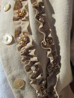Embellishing a cardigan with ruffles and beads.