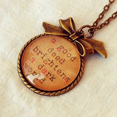 "Antique Bronze Necklace with ""A Good Deed Brightens a Dark World"" Quote Pendant"