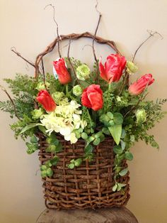 Custom floral arrangement spring door hanger in wooden basket with branch sticks, tulips, hydrangea, periwinkle and maiden hair fern greenery. Fall Wreaths, Easter Wreaths, Door Wreaths, Wreath Crafts, Diy Wreath, Front Door Decor, Baskets On Wall, Summer Wreath, Spring Flowers