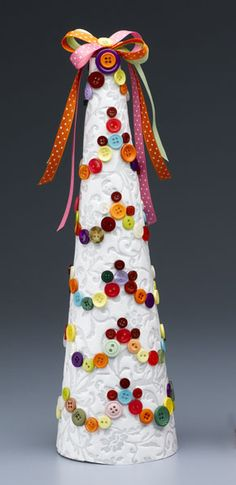 Garland of buttons on paper covered cone