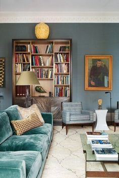 Love the soothing shades of blue in this cozy living room library.