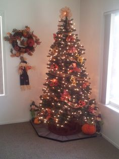 Our First Thanksgiving Tree...2013! :   ) With ornaments saying what were thankful for each year! Yay