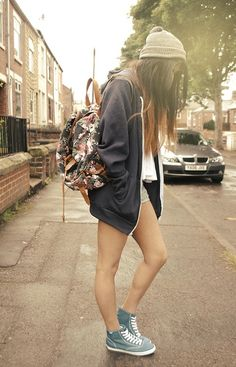 beanie. ombré long hair. oversized jacket. white flowy top. shorts. backpack. sneakers.