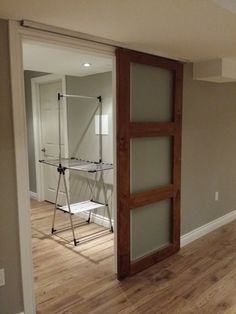 DIY barn door can be your best option when considering cheap materials for setting up a sliding barn door. DIY barn door requires a DIY barn door hardware and a Doors Interior, Low Ceiling, Closet Doors, Custom Door, Home, Barn Door Hardware, Interior, Sliding Doors, Interior Barn Doors