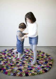 Nonna Pepa carpet  Nonna Pepa is a handmade carpet composed by pure wool flowers sewed on a felt base.  It exists in its multicolored, black/grey mélange, black or white versions, rectangular or circular.