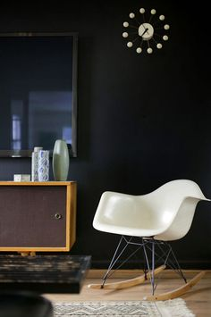 black wall - eames rocking chair - 60's sideboard