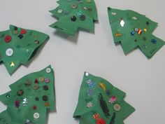 We made Christmas tree paper pillows in preschool