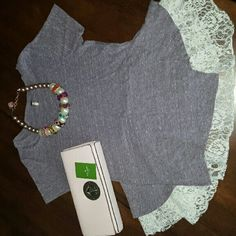 Free People tee with lace Beautiful tee from Free People with gorgeous lace detailed trim. Top has been gently worn and still has plenty of life left in it. Make me an offer!  Kate Spade Handbag not included but available in another listing in my closet. Necklace not included. Free People Tops Tees - Short Sleeve