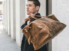 Use our new spacious leather men's duffle bag for your next weekend away or, take it with you as hand luggage for your next long haul adventure. Mens Leather Satchel, Leather Backpack For Men, Leather Duffle Bag, Leather Men, Leather Bags, Duffle Bag Travel, Duffle Bags, Travel Bags, Denim Fashion