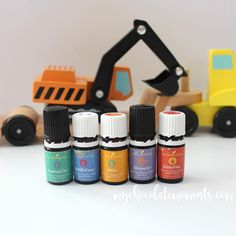 I love love the Kidscents oils that Young Living offers!  They make it so easy to know what oils to use with my littles.  Tummygize and Owie are our two MVPs of the bunch for sure. (P.S. Hudson, who is almost 3, loves to help me stage my pictures.  I asked him to pick out a toy for me to use as a background for this shot and I think he chose perfectly 😊)