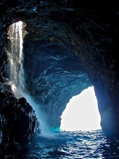 Waterfall Inside a Sea Cave on the Napali Coast! Wa'iahuakua Sea Cave Waterfall, Kauai The Wa'iahuakua Sea Cave on the coast of Kauai, Hawaii is considered one of the most beautiful sea caves in the world. Places Around The World, Oh The Places You'll Go, Places To Travel, Places To Visit, Travel Things, Travel Stuff, Dream Vacations, Vacation Spots, Kauai Vacation