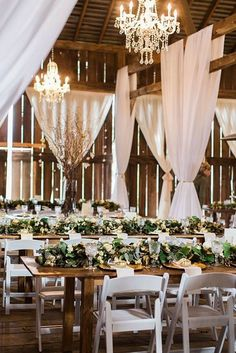 rustic barn wedding reception with greenery on wooden table #wedding #weddingideas #barnwedding