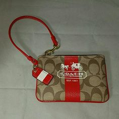 "COACH Brown Heritage w/ Red Stripe Wristlet Brand: Coach  Item:  *Brown Faux Leather Signature Wristlet with Red Stripe.   *Hang Tag is Red on the Front with a White Stripe, the Back is White. *Brass Hardware  Color: Brown, Red  Size: 6""w x 4""h  Condition: Light wear to one side of the interior from holding keys.  Exterior is excellent.  * no trades, offers via offer button only.  thank you! * Coach Bags Clutches & Wristlets"