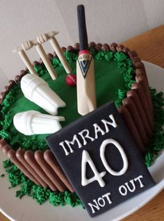 Cricket Players 40th Birthday Cake complete with bat, pads, wickets & ball