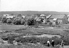 """Historic view of Zoar Historic District, c. .1900. The Village of Zoar is a well-preserved early 19th-century communal village. Zoar was founded in 1817 by a group of German """"Separatists"""" fleeing religious persecution. They obtained a loan from the Quakers and purchased 5,500 acres along the Tuscarawas River, and formed the communal society. Everyone's property and earnings became common stock and men and women had equal political rights in the community."""