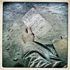 (Gardi) Lieutenant Robert Rain holds a letter he received from an Afghan man during a tribal meeting or shura with villagers of Kunder in Helmand Province, Afghanistan on October 27, 2010.This hand-written statement was given to the man by the commander of the previous US Marines unit acknowledging the death of the man's daughter, provided so the man could prove the loss and ask for compensation in the future.