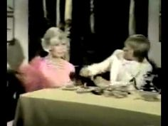 From John Denver's 1974 TV special, A Family Event.  This sketch features Denver, Doris Day, and George Gobel.  It's basically a running joke on Doris Day's virginal movie image.  SGS