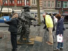 https://flic.kr/p/FLu4vM   2015.04 - Amsterdam photo of outdoor art - The Nightwatch-painting of Rembrandt in a bronze sculpture group, at the square Rembrandtplein; a geotagged free urban picture, in public domain / Commons CCO; city photography by Fons Heijnsbroek, The Netherland   Amsterdam photos, urban outdoor art - A group of bronze sculptures at the square Rembrandtplein in the center of the city. It was a rainy day in Spring, with only a few interesting tourists. This sculpture…
