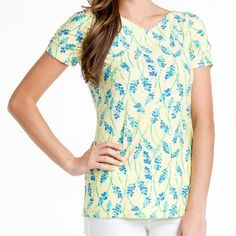 Lilly Pulitzer Yellow + Blue Floral Leila Tee Beautiful sunshine-inspired floral t-shirt, with whispy blue florals throughout. 100% Cotton. Subtle v-neck styling. Ruching at sleeves. Pre-loved but in excellent condition. No rips or stains. Best worn in Florida with your favorite skinny jeans {shopping on Worth Avenue in Palm Beach!} Lilly Pulitzer Tops Tees - Short Sleeve