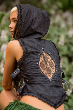 Our beautiful Maya Festival Vest is hand-made with cotton and lace, side buckles and an large hood. This vest has a fitted design, featuring buckles