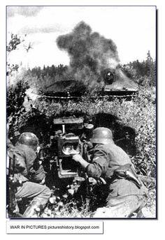 A German 50 mm anti-tank gun hits a T-34 tank