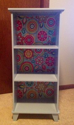 Bathroom shelf repurposed into a cute shelf for girls room. Paint and fabric and modge podge.