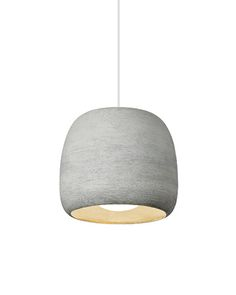Hand-painted ceramic material surrounds the light of the Karam pendant by @techlighting,  creating a story of scale and texture in concrete or black finishes.