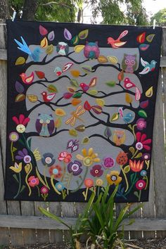 Few too many birds but I love the idea of the branches, birds and flower border :-) applique quilt