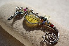 RESERVED.  YELLOW seahorse wire wrapped seaglass pendant.. $192.00, via Etsy.